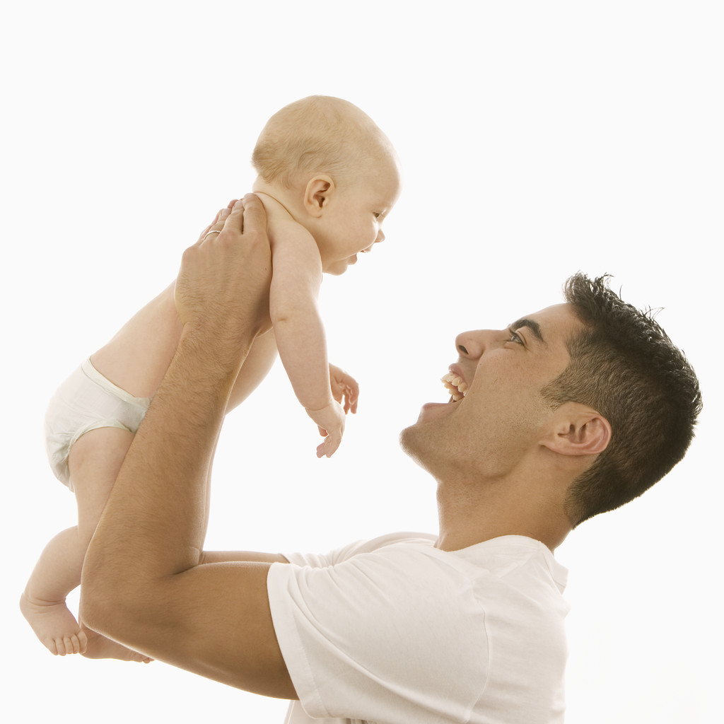 Man Holding Up an Infant | UberFacts